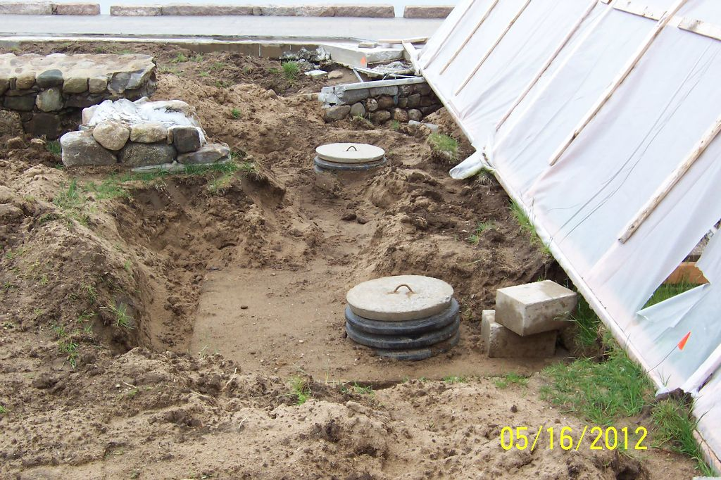 Exposed septic tank from the storm